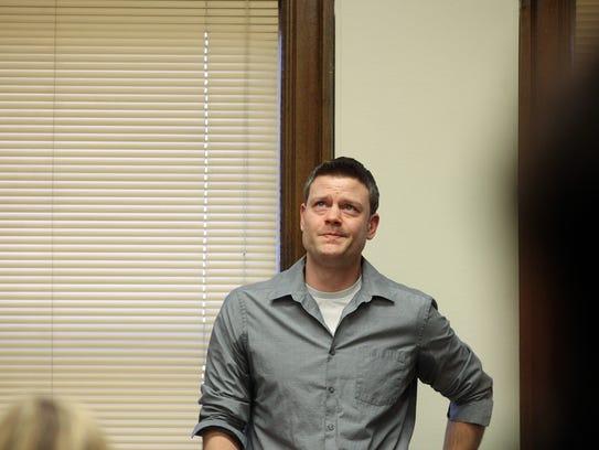 Jason Kersten, son of Susan Kersten, recites lyrics