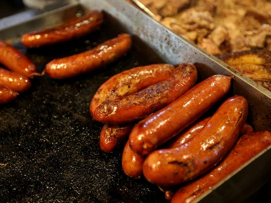 Bratwursts are prepared during the ninth annual Wurstfest,