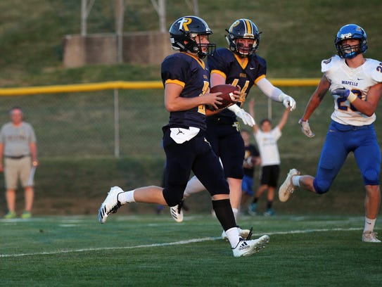 Regina's Michael Conlon runs in for a touchdown during