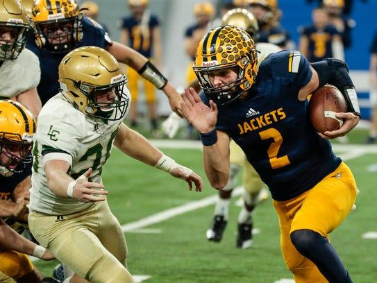 Ithaca quarterback Joey Bentley (2) runs against Jackson