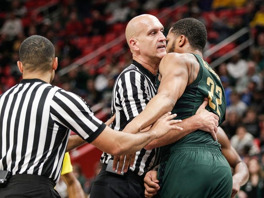 Referees try to calm down Michigan State's Miles Bridges