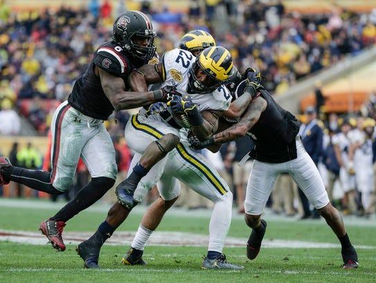 Michigan Wolverines running back Karan Higdon is tackled
