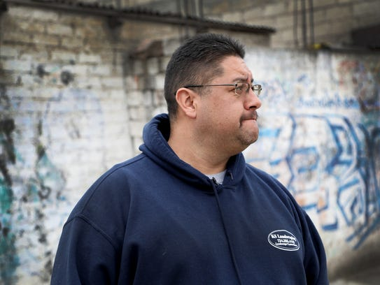 Jorge Garcia was deported from Detroit and  he is photographed