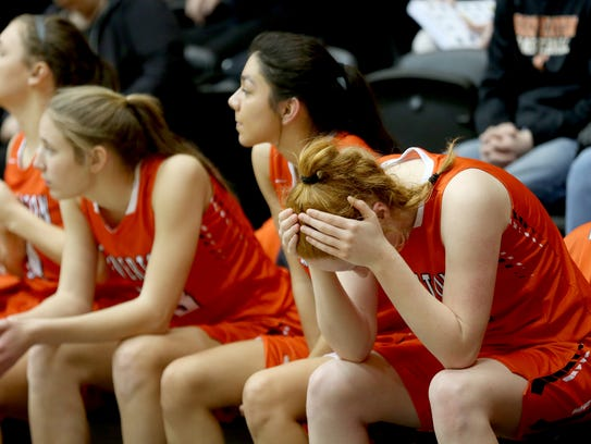 Silverton's Riley Traeger (34) puts her hands to her