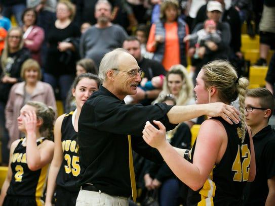 Cascade Coach Mark Stevens embraces senior Halle Wright