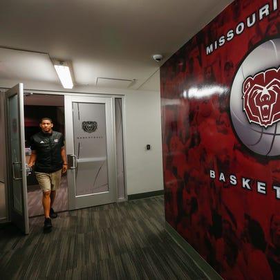 Missouri State head basketball coach Dana Ford walks