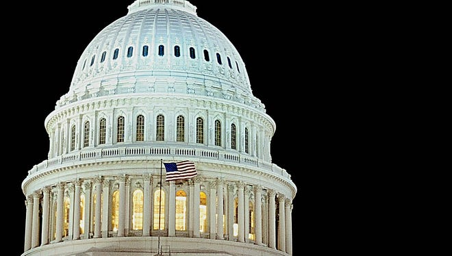 AFP/Getty Images The US flag flies in front of the US Capitol dome on December 24, 2008 in Washington, DC. AFP PHOTO/Karen BLEIER (Photo credit should read KAREN BLEIER/AFP/Getty Images)