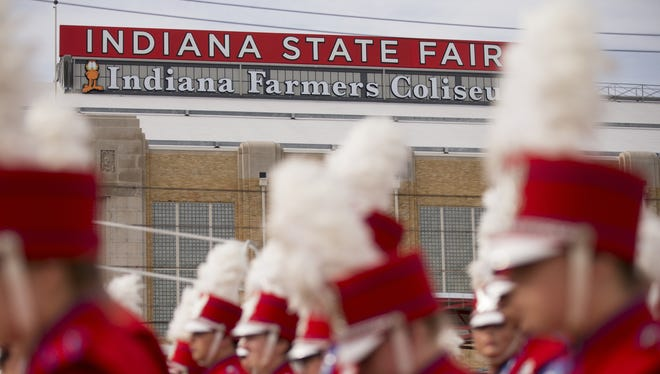Indiana Farmers Coliseum forms a backdrop for the Elwood Jr./Sr. High School band at the annual Band Day competition at the Indiana State Fair in Indianapolis on Saturday, Aug. 6, 2016.