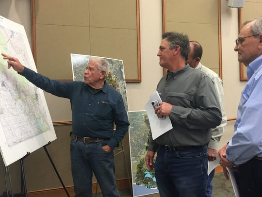Lafayette resident Harold Schoeffler and others discuss