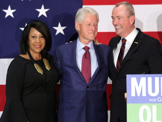 Sheila Oliver, Bill Clinton and Phil Murphy are shown during a rally in Paramus on Oct. 24.