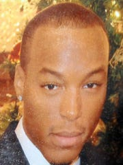 Copy of a family photo of murder victim Brandon Reliford.