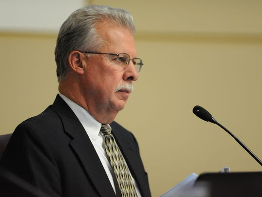 A file photo showing Washoe County Family Court Judge David Humke. The photo was taken in 2014 and shows Humke, who at that time was a Washoe County commissioner, listening to public comment.