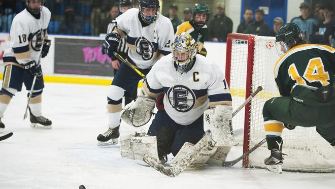 Essex goalie Erik Short (1) keeps his eye on the puck during the boys hockey game between the BFA St. Albans Bobwhites and the Essesx Hornets at the Essex Skating Facility on Wednesday night December 23, 2015 in Essex.