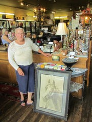 Terry Crawford of Christmas Valley poses with an agreeable piece of art she found at The Red Bench in downtown Silverton.