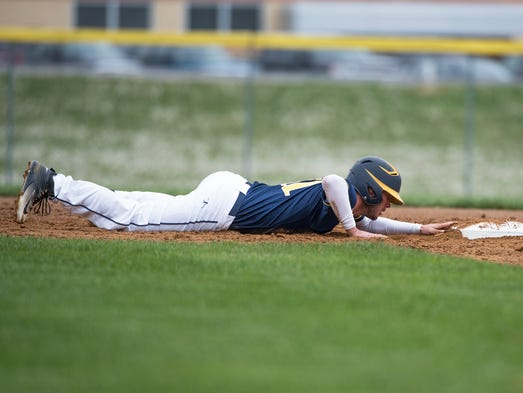 Greencastle's Shawn Keller slides into second base