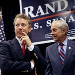 In this Oct. 2, 2010, file photo, Rand Paul appears with his father, Ron Paul, during a campaign event in Erlanger, Ky.