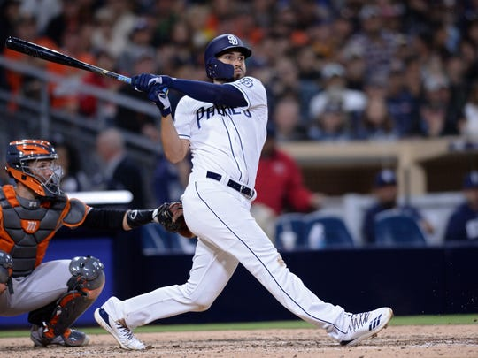 San Diego Padres' Eric Hosmer watches his two-run double  during the sixth inning of a baseball game Saturday, March 30, 2019, in San Diego. (AP Photo/Orlando Ramirez)