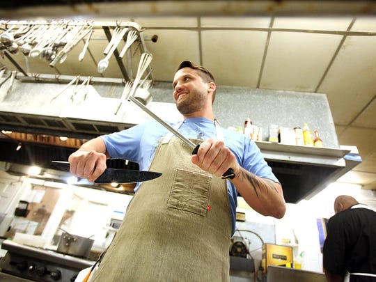 Chef Jonathan Kastner sharpens a knife during his first day on the job at Cafe Vermilionville Monday, June 1, 2015, in Lafayette, La.