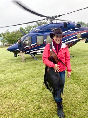 Megan Repass, with the helicopter that took her and numerous others out of the Bob Marshall Wilderness Area in June.