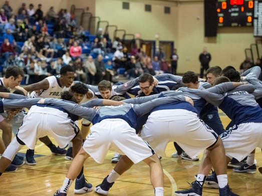 Chambersburg Trojans huddle and get pumped up before