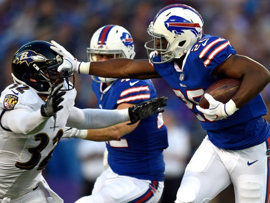 "FILE - In this Aug. 26, 2017, file photo, Buffalo Bills running back LeSean McCoy, right, rushes past Baltimore Ravens strong safety Eric Weddle during a preseason NFL football game in Baltimore. McCoy maintains confidence in the talent the Bills have. ""Everybody's entitled to their own opinion,"" McCoy said. ""My sense in guys I'm playing with and for is we're trying to win now."" (AP Photo/Gail Burton, File)"