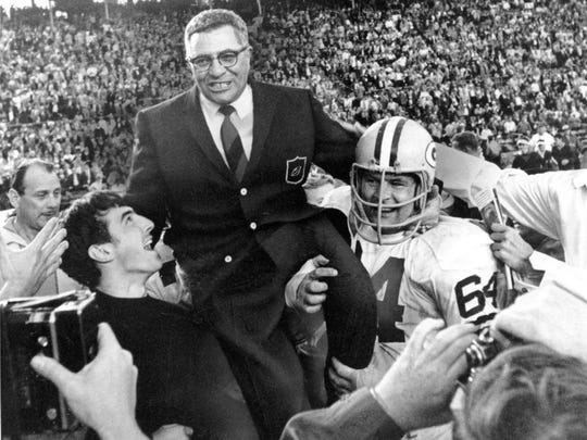 Green Bay Packers coach Vince Lombardi is carried off the field on Jan. 14, 1968, after his team defeated the Oakland Raiders 33-14 in Super Bowl II in Miami. Former Packers great Jerry Kramer is at right.