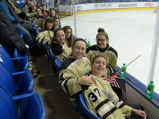 Sitting in the front row at USA Hockey Arena are Honeybaked 14U girls players Callie Shanahan, Annabelle Scriver, Liz Kramp, Miranda Triolet, and Rachel Vaughn.