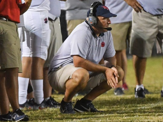 Belton-Honea Path head coach Russell Blackston watches his team play Palmetto during the third quarter at Palmetto High School in Williamston on Friday.