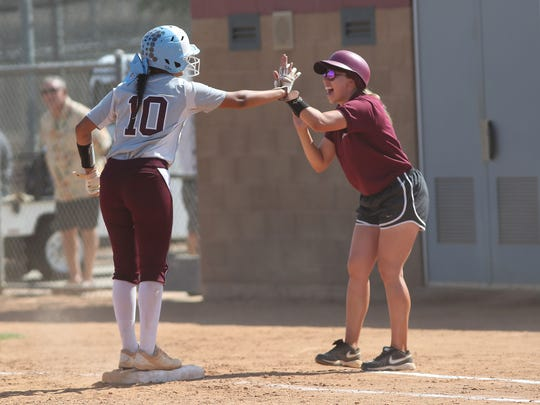 Christine Correa gets a high-five from the coach after getting a hit for Rancho Mirage in their game against Mary Star, May 24, 2018.