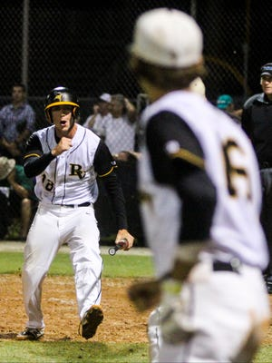 Bishop Verot's Austin Saunders celebrates as he runs to the his teammates after scoring in the bottom of the sixth inning to put them up 1-0, which ended up being the final score.