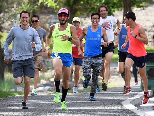 Luis Contreras, middle in yellow, leads the Runny Bums to victory in the Reno Tahoe Odyssey race at Idlewild Park in Reno on May 30, 2015. The 178-mile relay race starts and ends in Reno and goes all the way around Lake Tahoe.