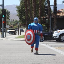 Riverside County Sheriff's Deputy Steven Nelson crosses Monterey Avenue in Palm Desert while dressed as Captain American. He was participating in a pedestrian safety enforcement operation.