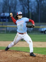 Gibson County's Sam McKinney (7) throws a pitch against