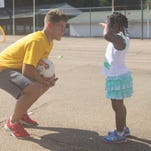 Michael Gonzalo, left, of Brilla Soccer Ministries, talks with a young girl at the organization's Urban Soccer Project at the Spencer Perkins Center in Jackson.
