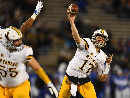 Wyoming quarterback Josh Allen, projected as the No. 1 pick in the NFL draft by ESPN analyst Mel Kiper Jr., throws a pass during a Nov. 11 game at Air Force.