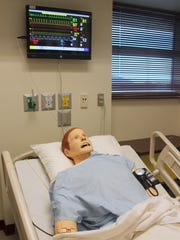 This SimMan, a patient simulator, is used to teach students how to start an IV, draw blood and many other medical features. The SimMan breathes, has a pulse, can talk and die.