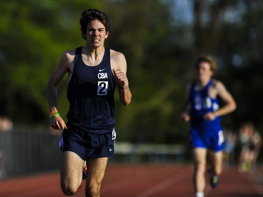 Tim McInerney of CBA races to the finish line in the1600m