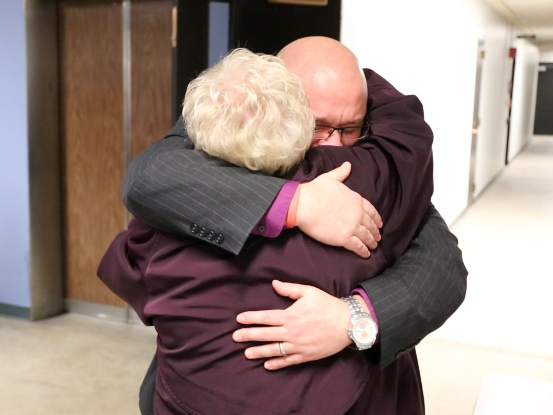 Tony Weers, superintendent of the Tri-Center School District hugs Rhonda McKenzie, business manager of the district, following a school budget review committee hearing where it was decided that their district would be granted their request for additional funding on Wednesday, Jan. 21, 2015, at the headquarters of the Iowa Board of Education in Des Moines, Iowa.
