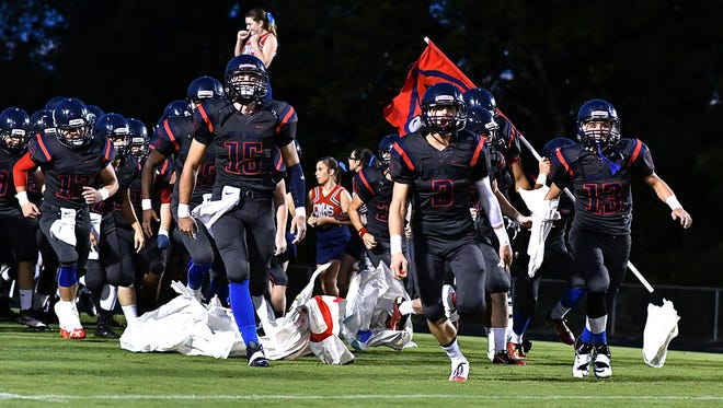 Creek Wood takes the field before Saturday's game against Fairview. Fairview at Creek Wood. Aug. 27. Red Hawk Stadium. MARTY ALLISON/THE DICKSON HERALD.