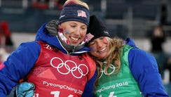 Kikkan Randall and Jessica Diggins celebrate winning