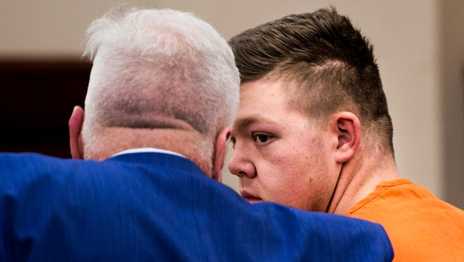 Christopher Conway looks to his attorney Ed Dewerff during his preliminary hearing on November 21, 2017.