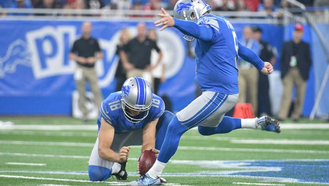 Lions kicker Matt Prater kicks a field goal as punter Jeff Locke holds during the game against the Falcons at Ford Field on Sept. 24, 2017