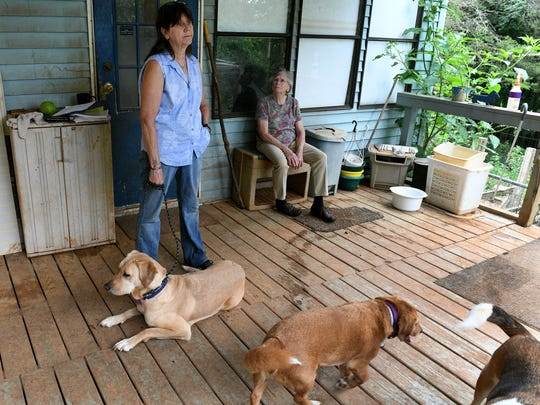 Stephen Blackwell's sister Cat Blackwell, left, and mother Judy Fleming, seated, are trying to carry on his rescue work and place some of his dogs Thursday, June 14, 2018. Blackwell, who owned Dogwood Daycamp kennel and fostering organization, was worried about losing his dogs and he killed himself after trouble with Roane County codes.