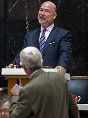 House Speaker Brian Bosma, top, laughs as he guides