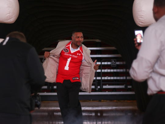 Austin Peay coach Todd Pinkston walks out in a jersey