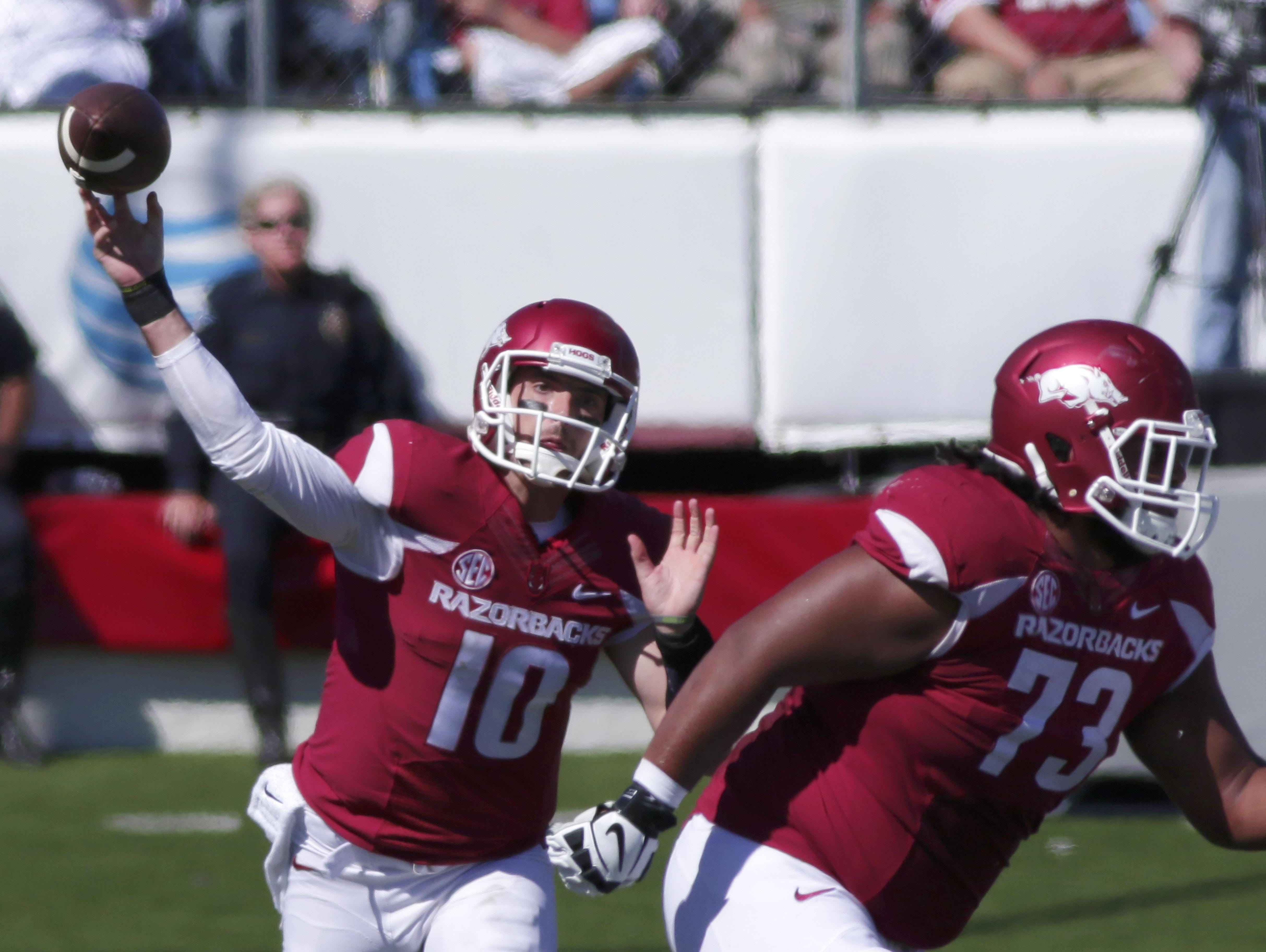 Arkansas quarterback Brandon Allen (10) is off to a career-best start, leading the SEC in passing with 720 yards after two games. But the Razorbacks are looking to back off the pass and focus on their running attack this week against Texas Tech.