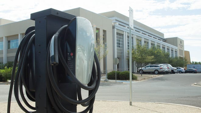 A Tesla electric car charger that the city of Las Cruces has installed in the parking area between Branigan Library and City hall. The City installed. two electric-car charging stations on city property, both are available for the public to use. 