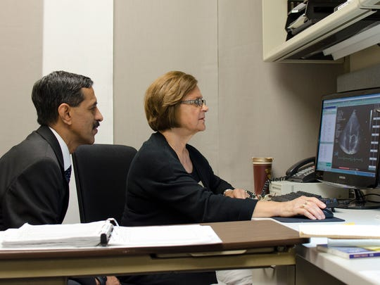 Dr. Vasan Ramachandran, the current principle investigator of the Framingham Heart Study, shown here studying an echocardiogram with sonographer Birgitta Lehmann.
