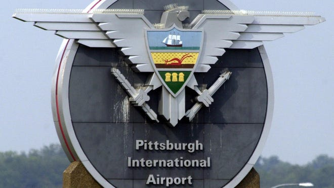 A sign for Pittsburgh International Airport is seen near an entrance to the airport on July 29, 2004.