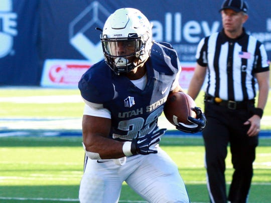 Utah State running back Devante Mays runs against Nevada